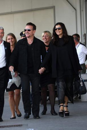 bono and ali arrive for george's wedding