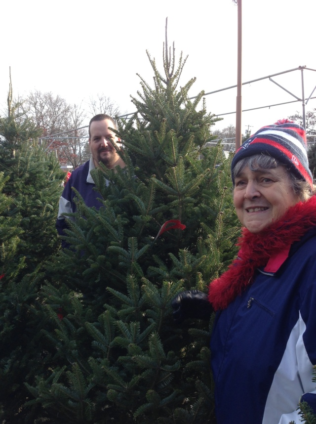 mom and joe with tree